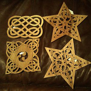 2 star trivets and 2 celtic ones