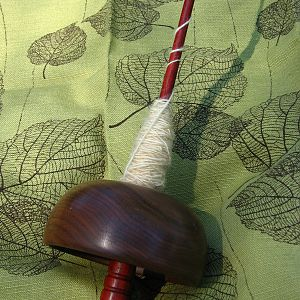 Drop spindle with a cupped whorl