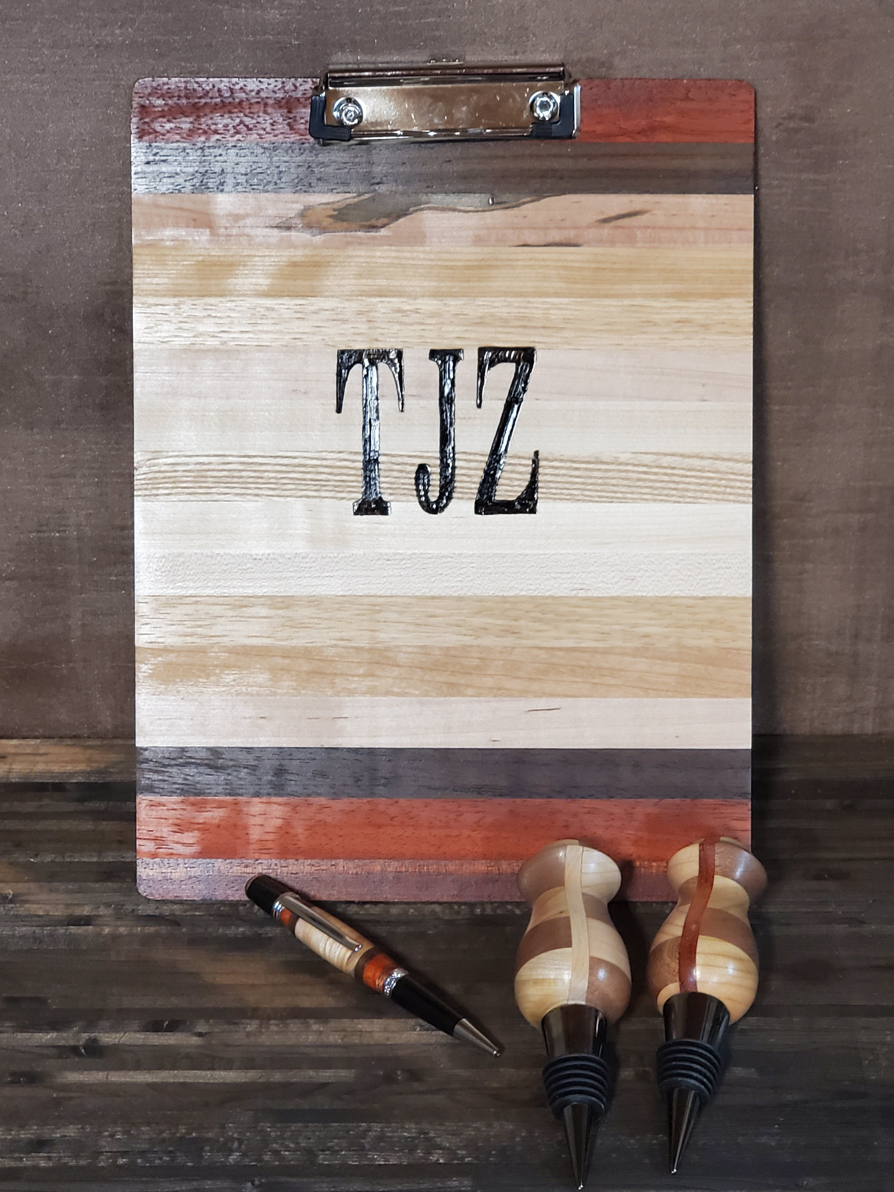 Clipboard with matching pen and bottle stoppers