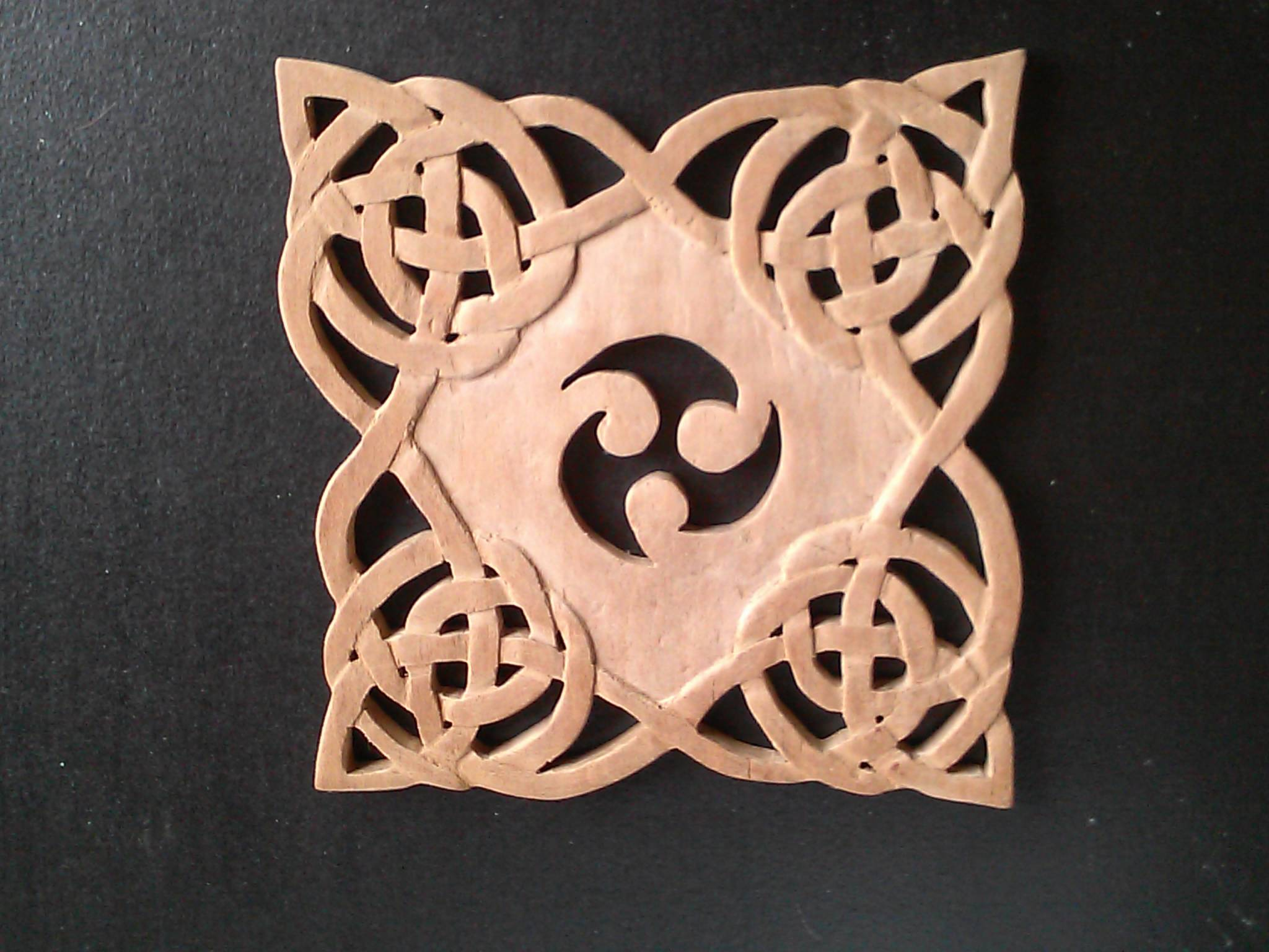 Scrolled and carved trivet
